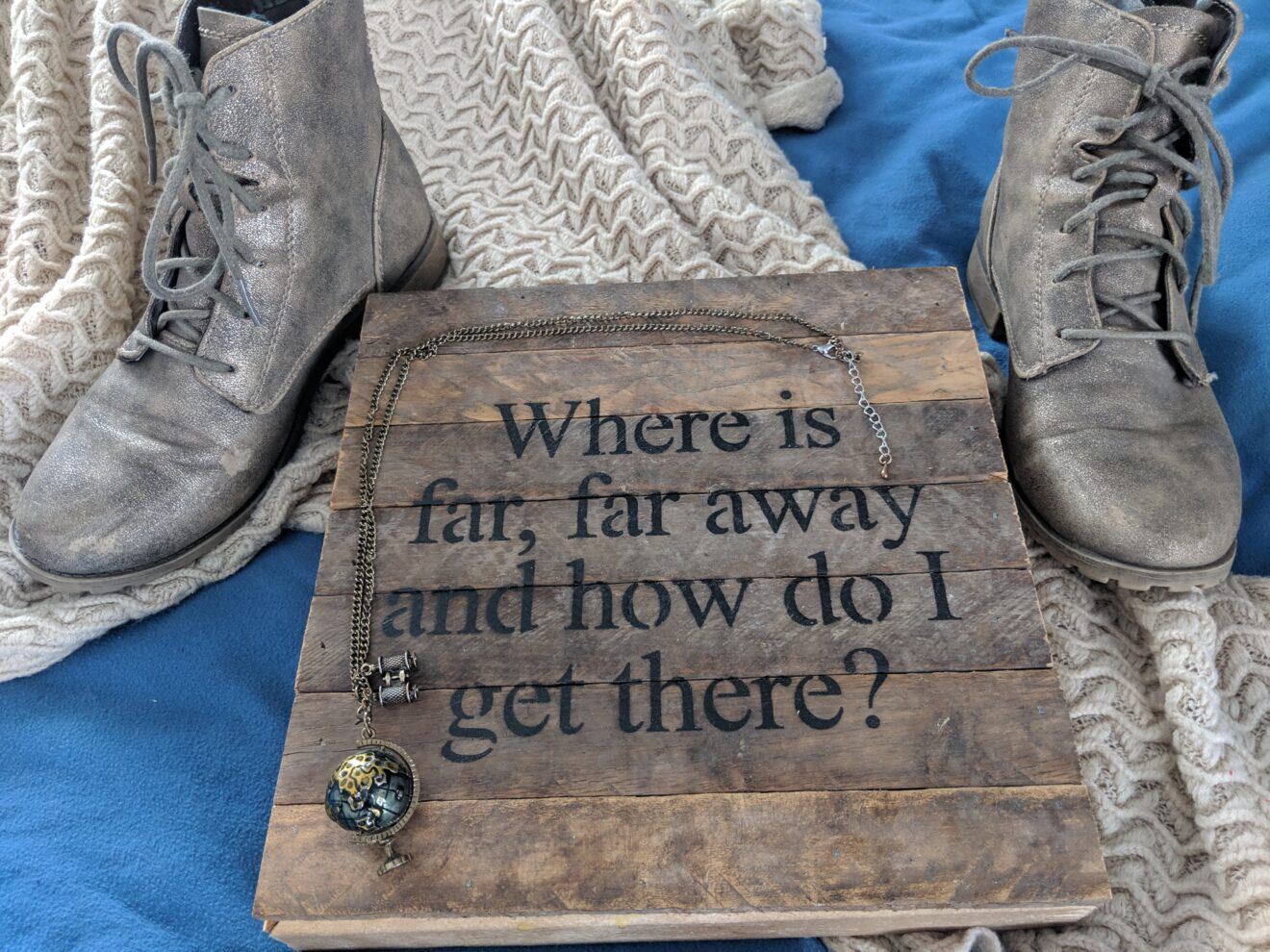 Story Behind the Cloth Where is far far away and how do i get there quote on wood canvas adventurous shoes earth globe necklace flatlay photography 3